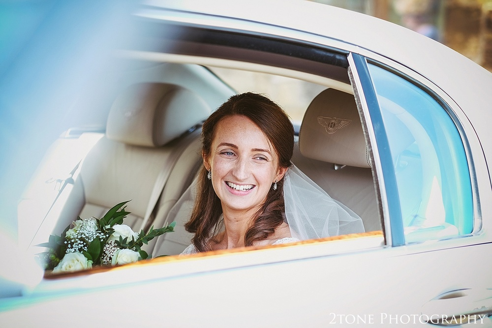 Bride arriving to church.  Durham Castle wedding Photography by Durham and Newcastle wedding photographer www.2tonephotography.co.uk