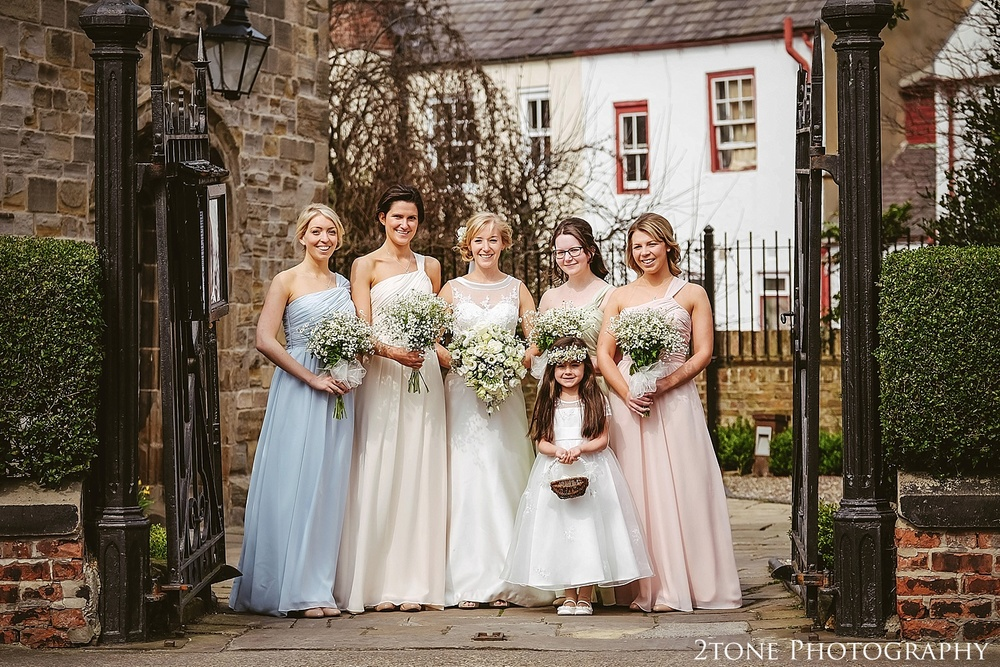 Colourful bridesmaids at St Cuthberts Church, Durham.  Durham wedding photography by wedding photographers www.2tonephotography.co.uk