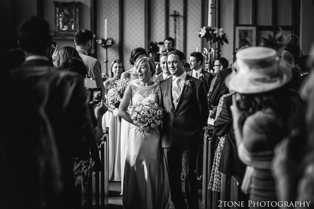 Exit of the Bride and Groom in St Cuthbert's Church, Durham.  Durham wedding photography by wedding photographers www.2tonephotography.co.uk