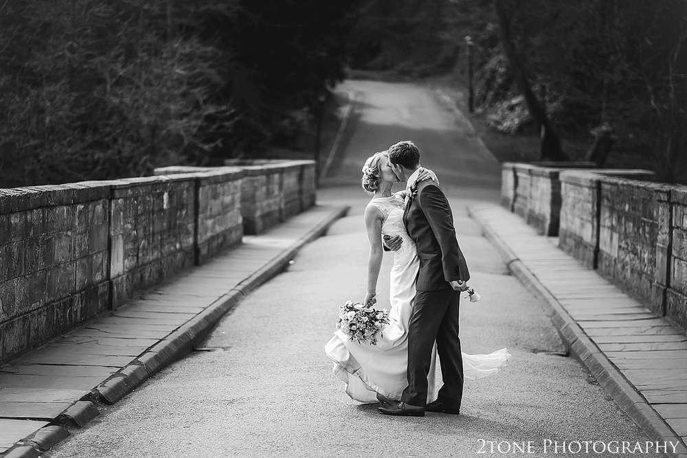 Wedding Couple on Prebends Bridge in Durham.  Durham wedding photography by wedding photographers www.2tonephotography.co.uk
