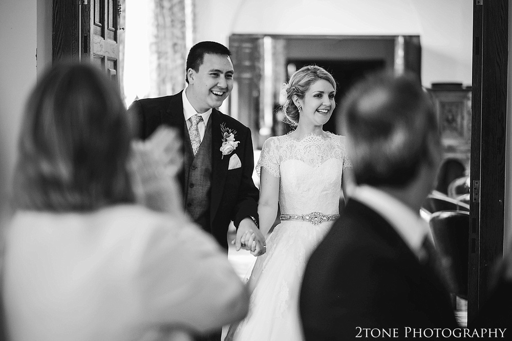 Bride and Groom announced into the Monboucher Suite.  Newcastle and Beamish Hall Wedding Photography by www.2tonephotography.co.uk