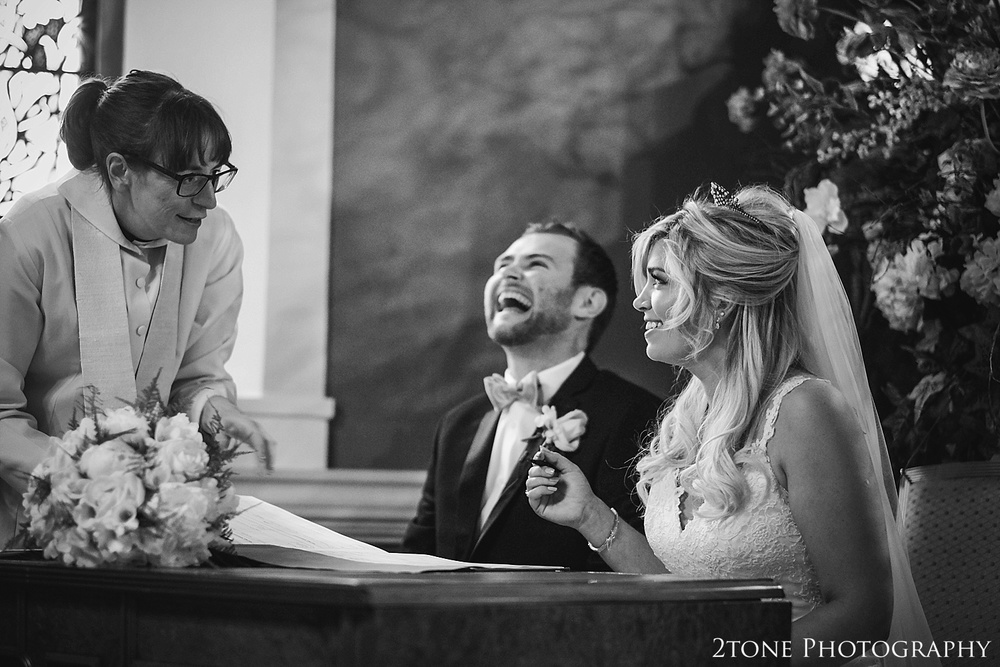 The signing of the register.  Wynyard Hall wedding photography by www.2tonephotography.co.uk