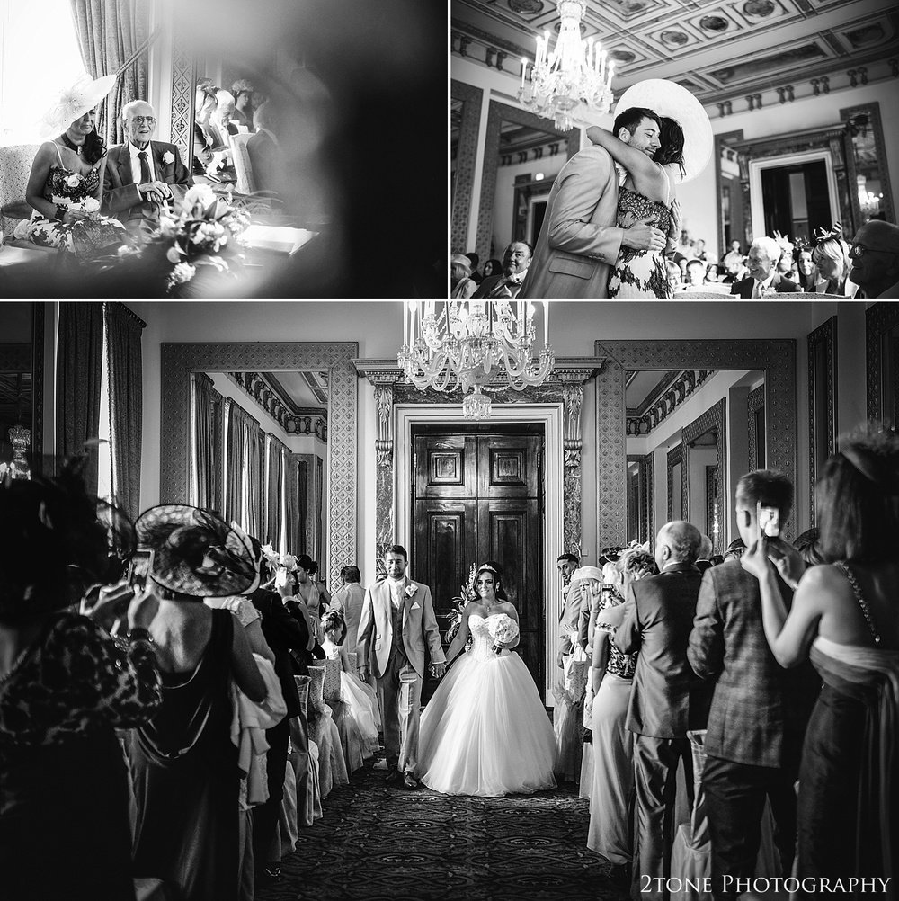 Exit of the bride and groom in the mirror room in Wynyard Hall by Newcastle and Durham based Wedding Photographer www.2tonephotography.co.uk
