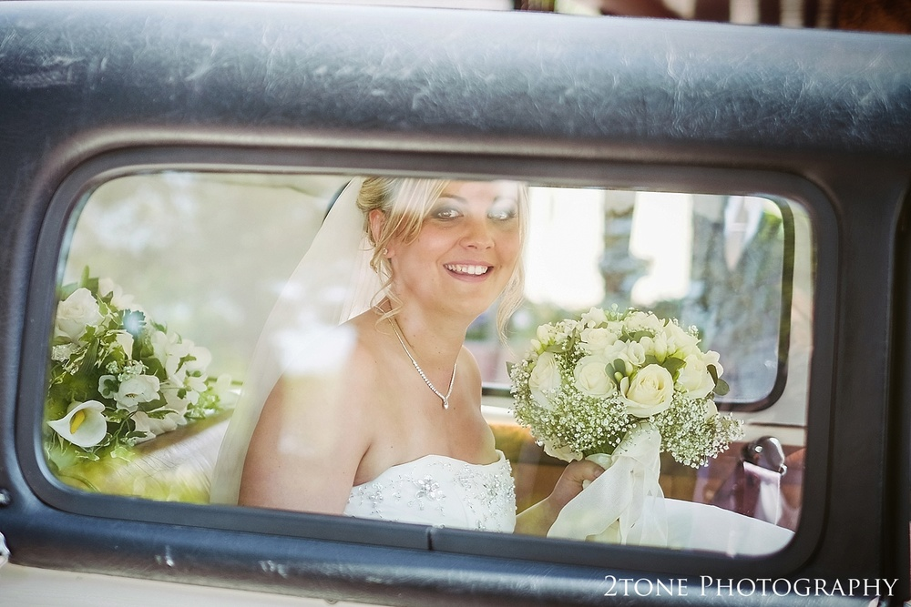 The bridal in the wedding car at St Cuthberts Seaham wedding photography by www.2tonephotography.co.uk