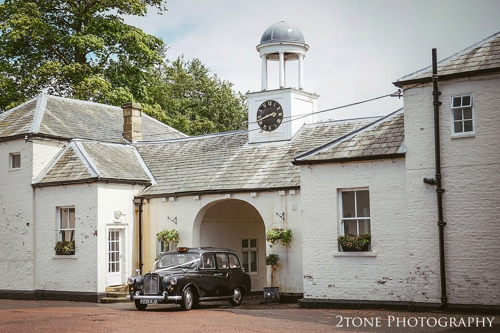 Newcastle photography.  Bride arriving at Kirkley Hall wedding.  2tone Photography