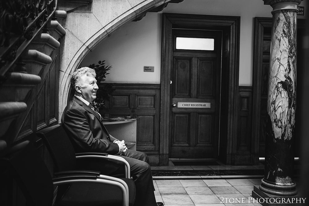 Groom prepares for the wedding.  Wedding Photography at the Lothian Chambers in Edinburgh by 2tone Photography
