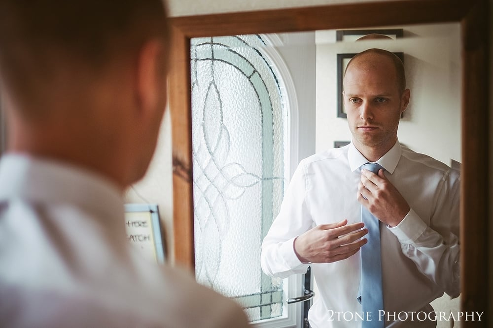 Groom getting ready for wedding in Newton Under Roseberry by 2tone Photography