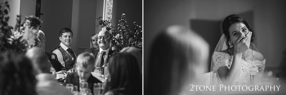 Wedding Speeches.  Natural wedding photography in a village hall by 2tone Photography www.2tonephotograhy.co.uk
