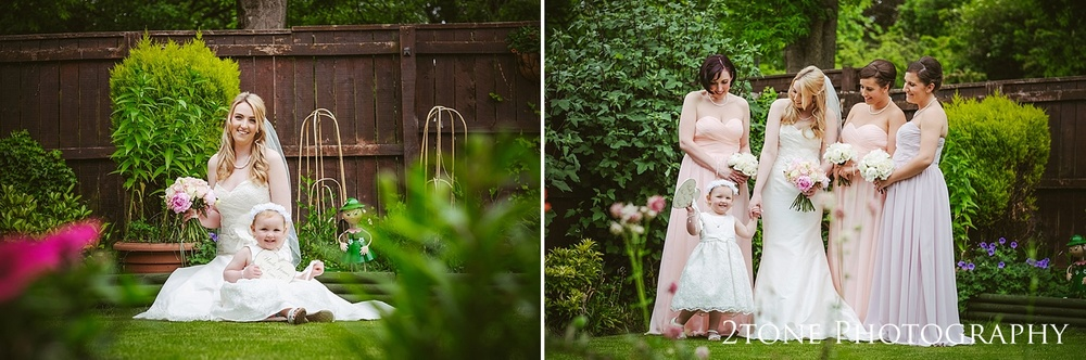 Bride in the garden by www.2tonephotograhy.co.uk