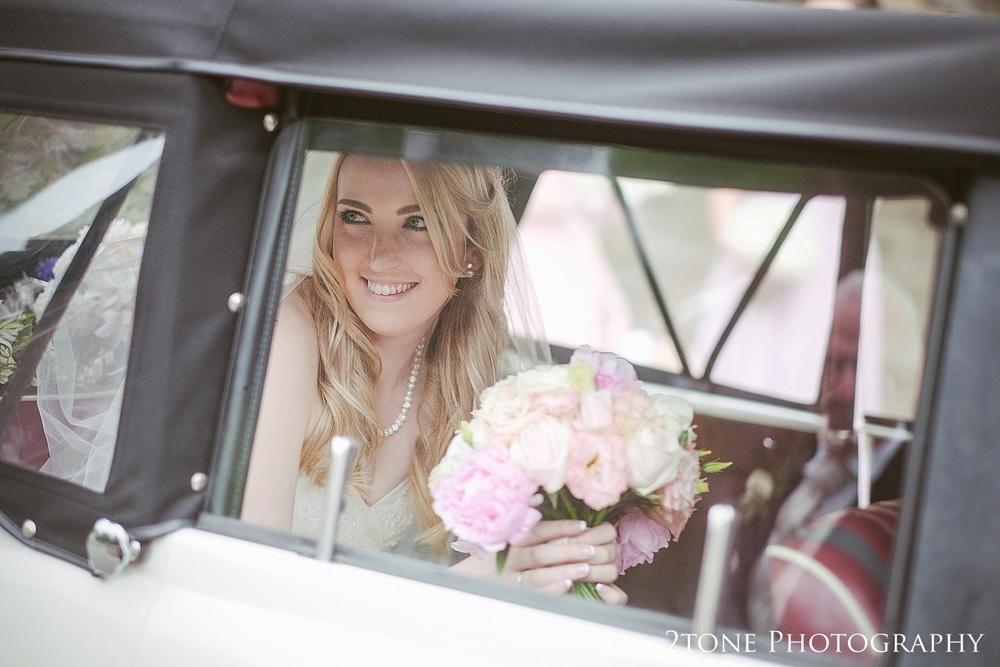 The bride arriving by www.2tonephotograhy.co.uk