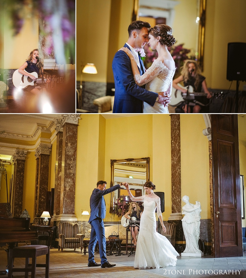 Bride and Groom dancing in the statue gallery to music by Jess Avison at Wynyard Hall by Durham based wedding photographers www.2tonephotography.co.uk