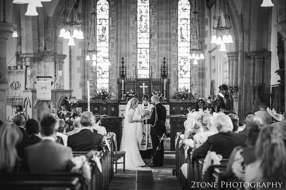 Wedding ceremony in Stamfordham church.  Wedding photography at Matfen Hall by wedding photographer www.2tonephotography.co.uk