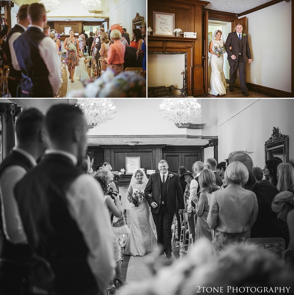 The bride walks down the aisle.  Wedding photography at Guyzance Hall by wedding photographers www.2tonephotography.co.uk