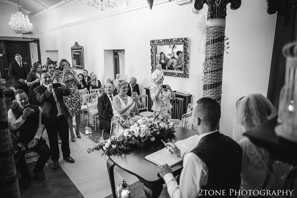 Signing the register.  Wedding photography at Guyzance Hall by wedding photographers www.2tonephotography.co.uk