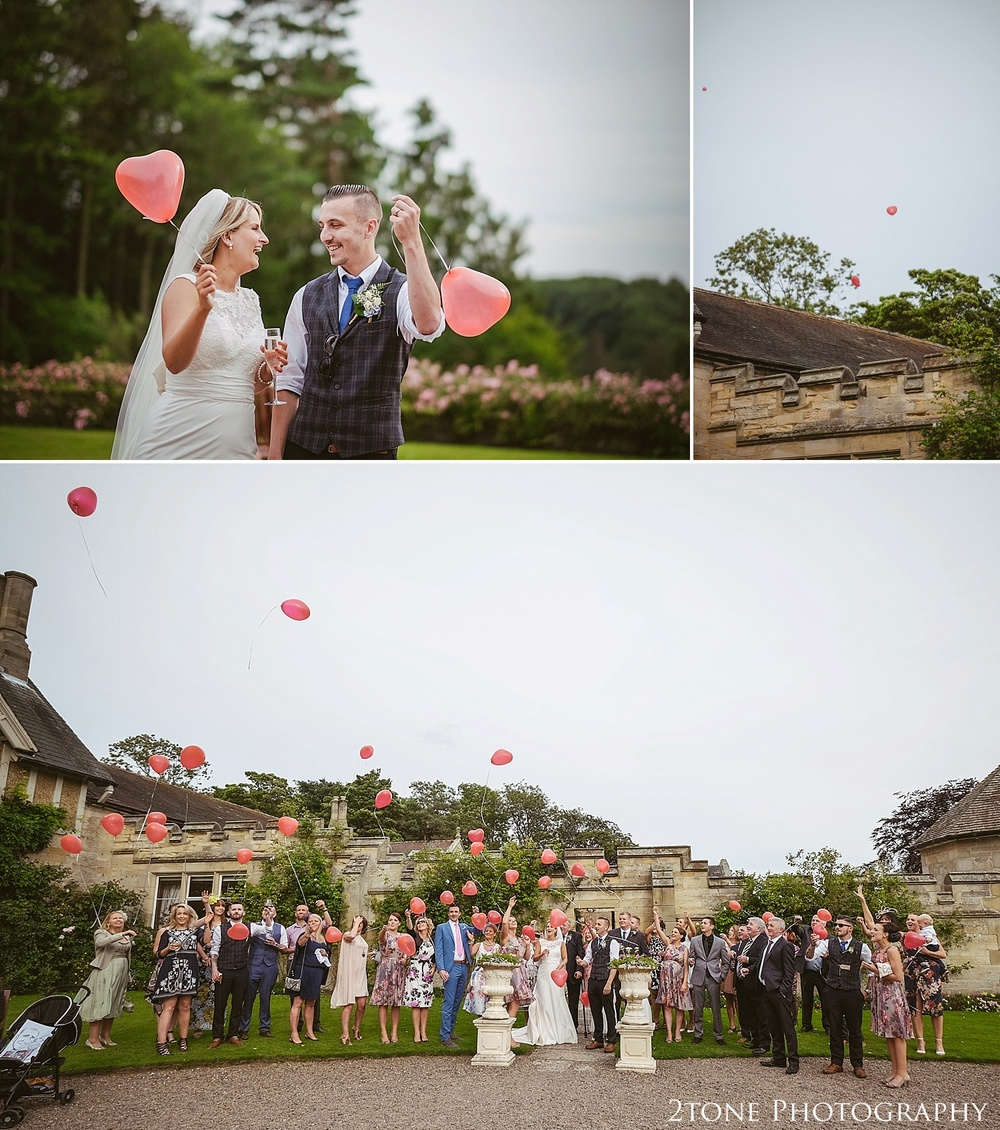 Balloon release.  Wedding photography at Guyzance Hall by wedding photographers www.2tonephotography.co.uk