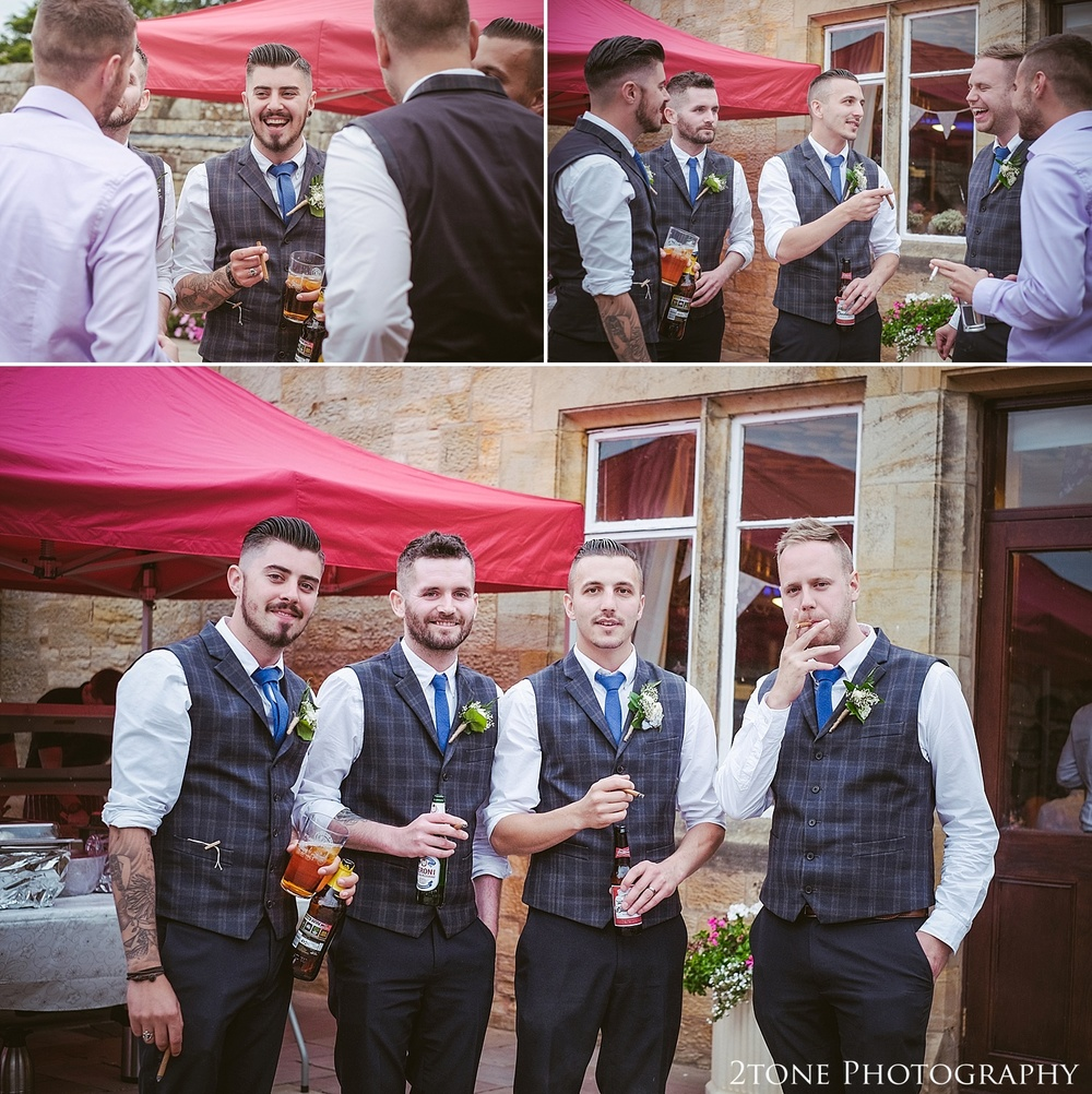 The groomsmen with cigars.  Wedding photography at Guyzance Hall by wedding photographers www.2tonephotography.co.uk