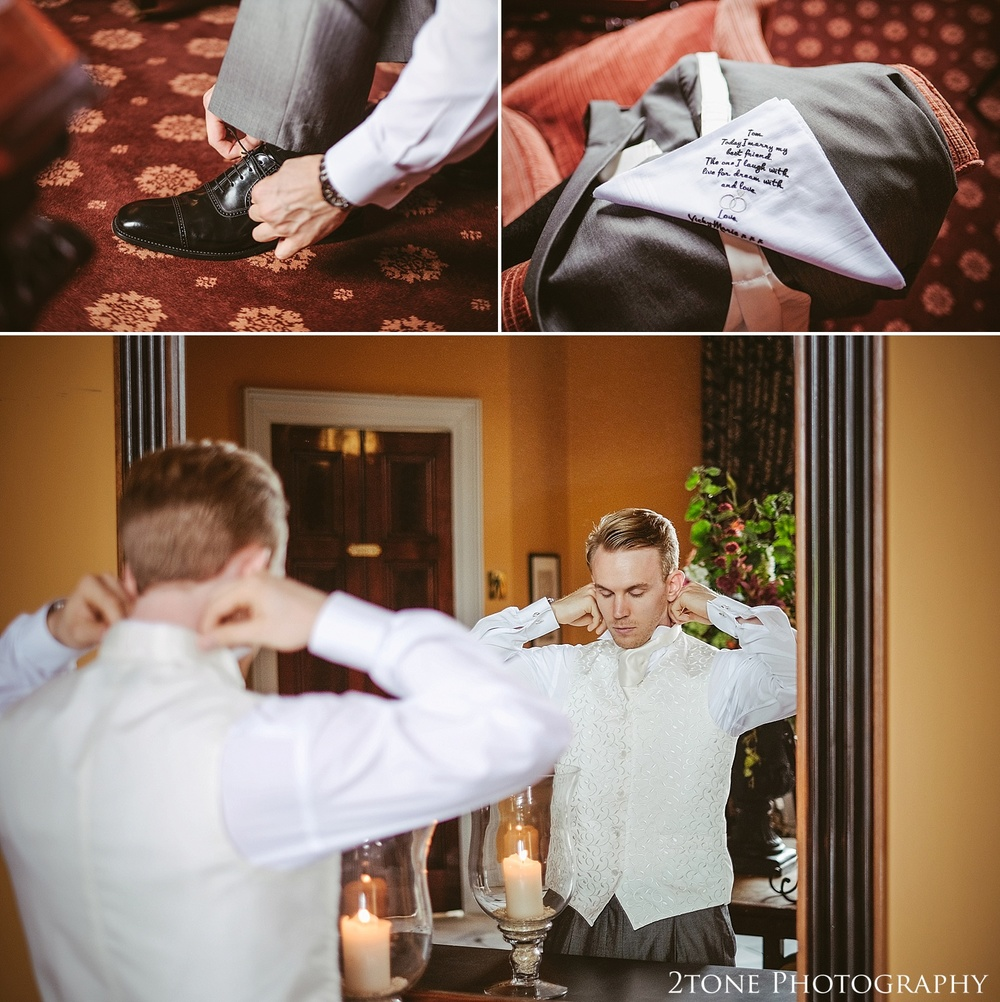 Groom getting ready.  Wedding photography at Wynyard Hall by husband and wife wedding photographers 2tone Photography www.2tonephotography.co.uk