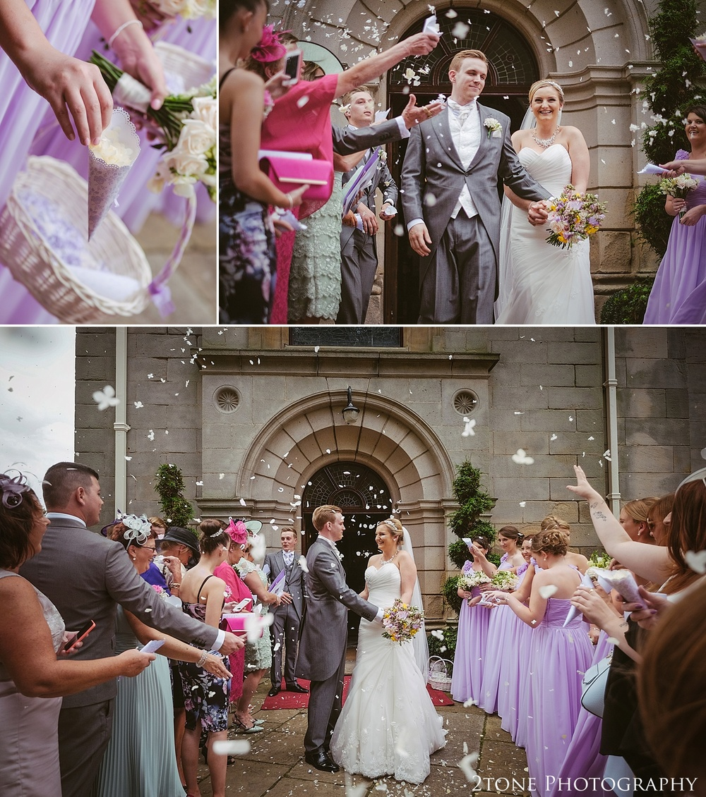 Wedding confetti at Wynyard Hall.  A chapel ceremony at Wynyard Hall.  Wedding photography at Wynyard Hall by husband and wife wedding photographers 2tone Photography www.2tonephotography.co.uk