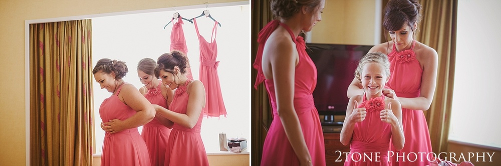 Bridesmaids get ready for a wedding at Slaley Hall wedding photography by wedding photographers 2tone Photography.  www.2tonephotography.co.uk