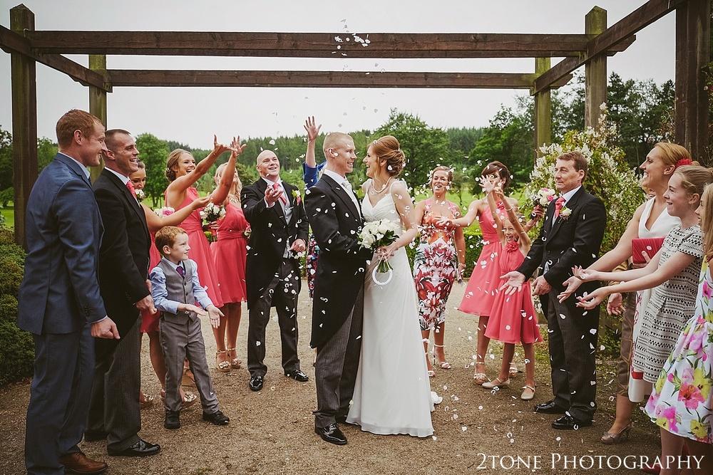 Wedding confetti.  Slaley Hall wedding photography by wedding photographers 2tone Photography.  www.2tonephotography.co.uk