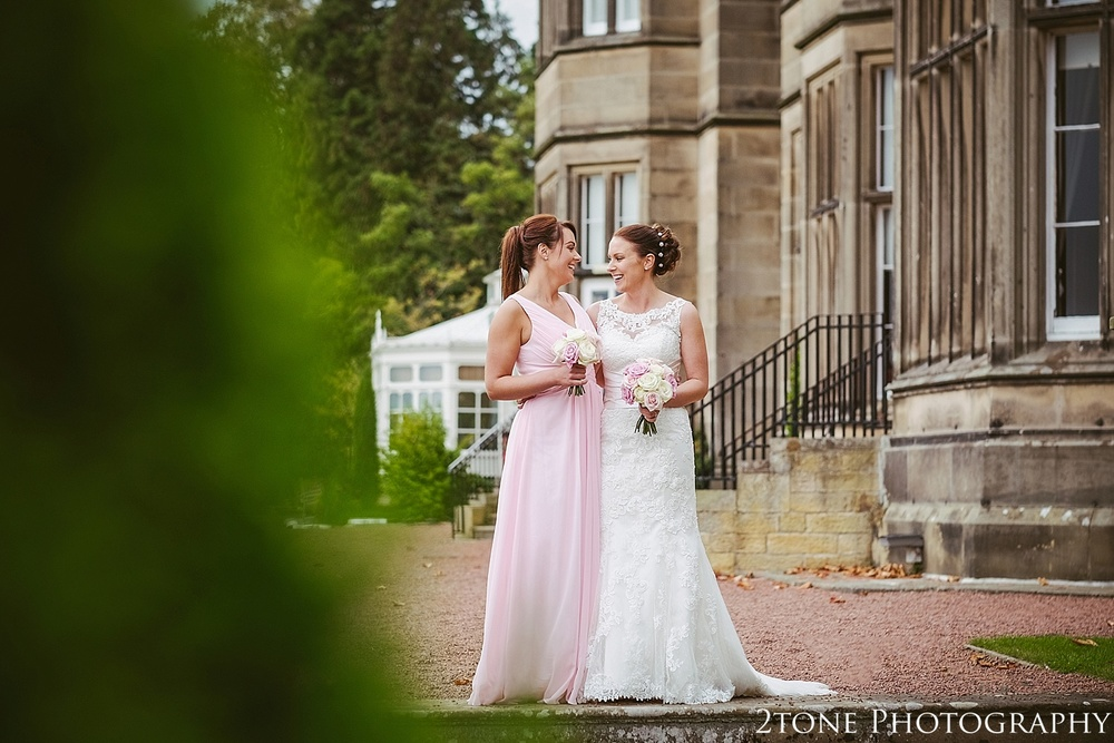 The bride and bridesmaid.  Matfen Hall by Durham based wedding photographers 2tone Photography www.2tonephotography.co.uk