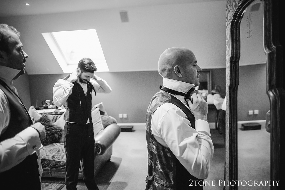 The groom getting ready at Ellingham Hall. Winter wedding photography by www.2tonephotography.co.uk