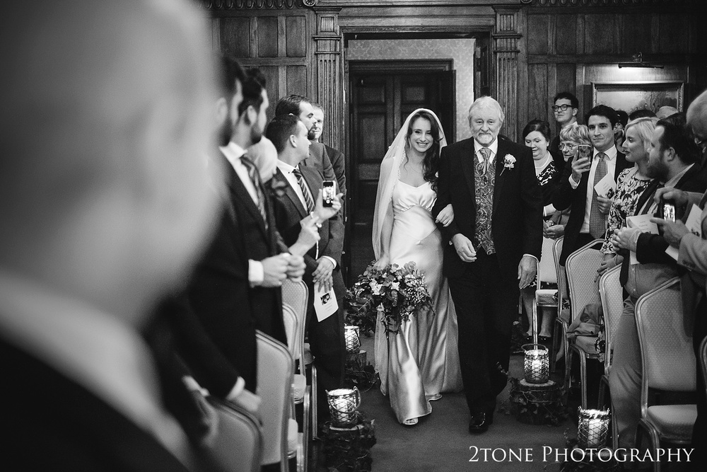 The bridal procession at Ellingham Hall. Winter wedding photography by www.2tonephotography.co.uk
