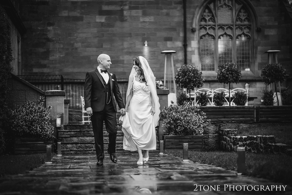 Rainy wedding days at Ellingham Hall. Winter wedding photography by www.2tonephotography.co.uk