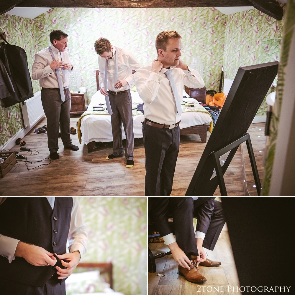 The groom getting ready at Woodhill Hall.  Wedding photography in Northumberland by www.2tonephotography.co.uk
