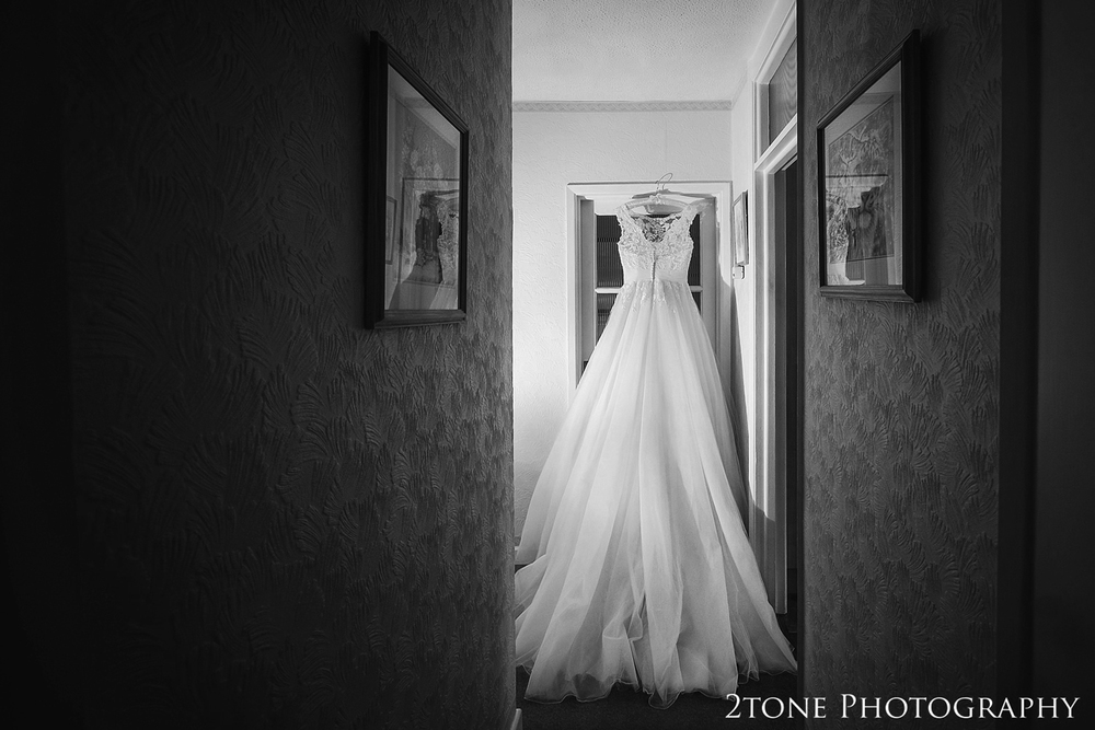 The wedding dress.  Creative wedding photography by husband and wife team 2tone Photography ww.2tonephotography.co.uk