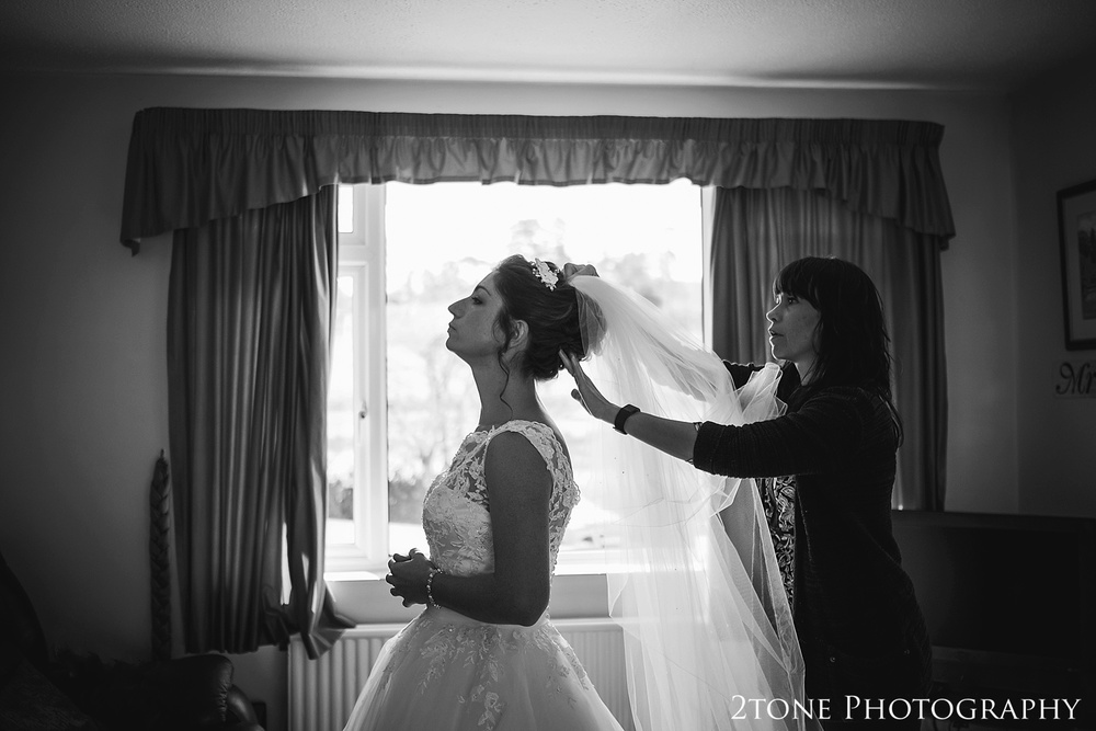The bride getting ready.  Wedding photography in Somerset by husband and wife team 2tone Photography ww.2tonephotography.co.uk