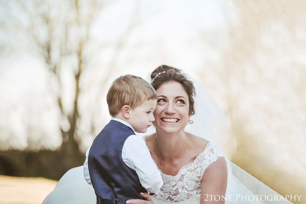 The bride and her son, natural wedding photography at Haselbury Mill and the Old Tythe Barn in Somerset by www.2tonephotography.co.uk