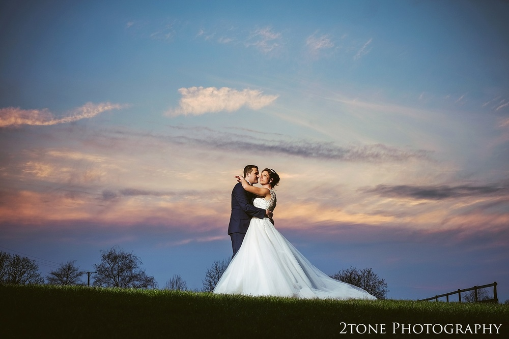 The bride and groom at Sunset at Haselbury Mill and the Old Tythe Barn in Somerset by www.2tonephotography.co.uk