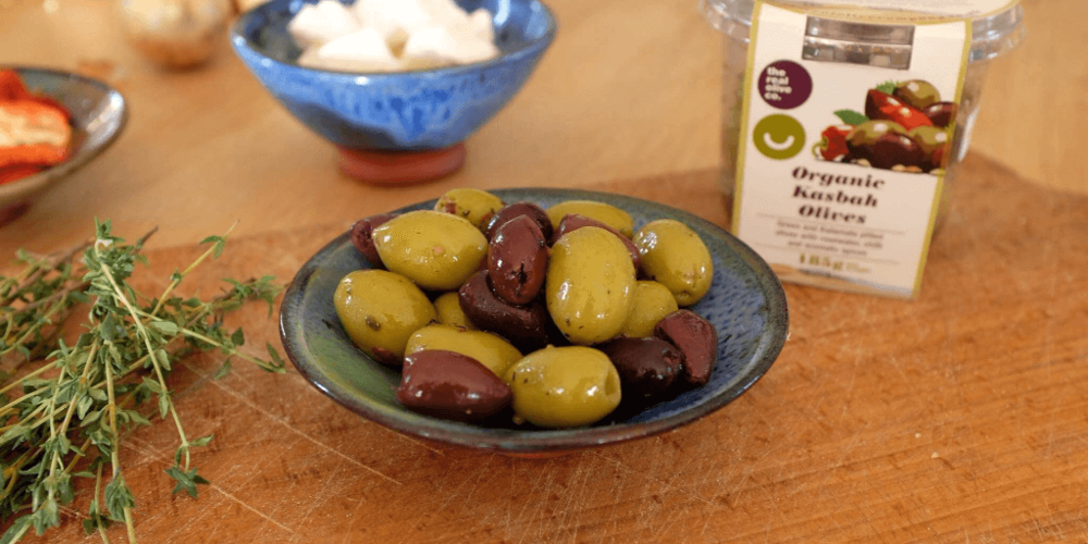 Real Olive Co. Olives in a snack pot