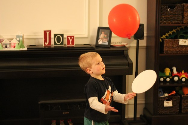 All you need are a couple of balloons, some paper plates and plastic spoons. Definitely  Toddler Approved .