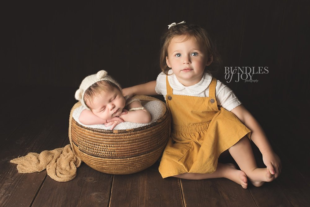 I love photographing newborn babies with their siblings