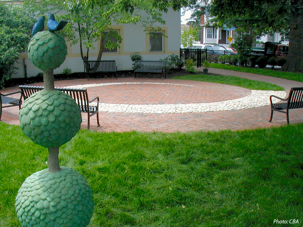 CBA prepared a Master Plan for the grounds of the Adams Street Public Library, which features three distinct gardens: the Children's Garden, the Chess Garden, and the Reading Garden. The first phase, which has been implemented, included the Childrens' Garden, with sculptures in the shapes of whimsical trees, a spiraling walk and patio, new benches and plantings. Funds are being raised to continue the implementation of the Master Plan.