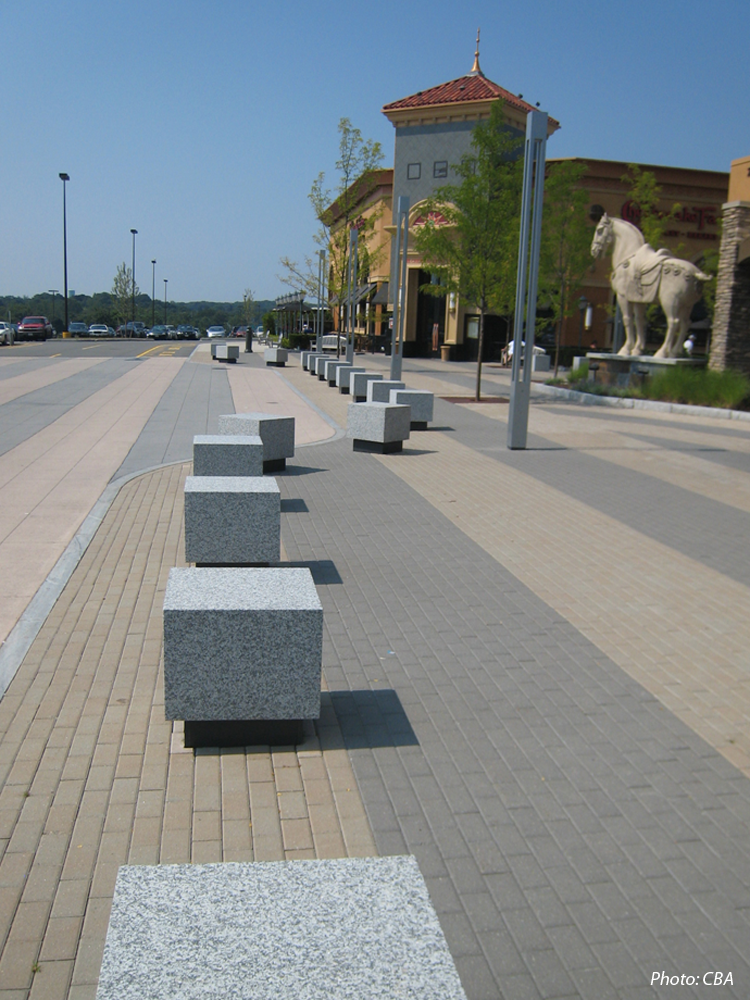 CBA Landscape Architects designed a major new entry plaza to the Northshore Mall as part of the 2007 mall expansion. Flanked on either side by new restaurants, the plaza design compliments the new architecture of the food court entrance. Striped pavement, granite blocks, contemporary pole lights, and randomly spaced Honey Locusts give the mall a strong visual identity and create a comfortable outdoor space for shoppers.