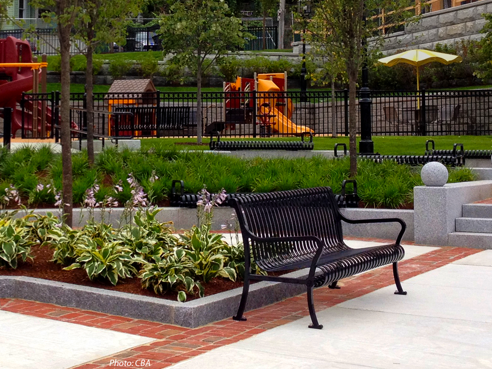 A new residential neighborhood is being created in the heart of Chelsea's former manufacturing area. One of the key components of the City's plan is this brand-new park on a significant corner. CBA's design combines a plaza area that draws visitors in, a water feature, stepped granite walls, a picnic area under a trellis, decorative brick and concrete paving, attractive fences, exciting play equipment, plantings, and open lawns to create a green respite with details and colors that reflect the industrial past.