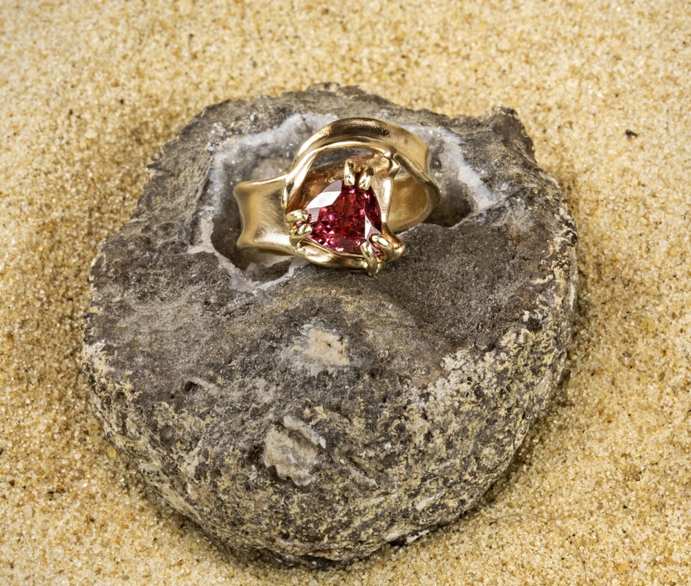 Eventide ring in 14k yellow gold with  Trilliant Cut  salmon pink tourmaline