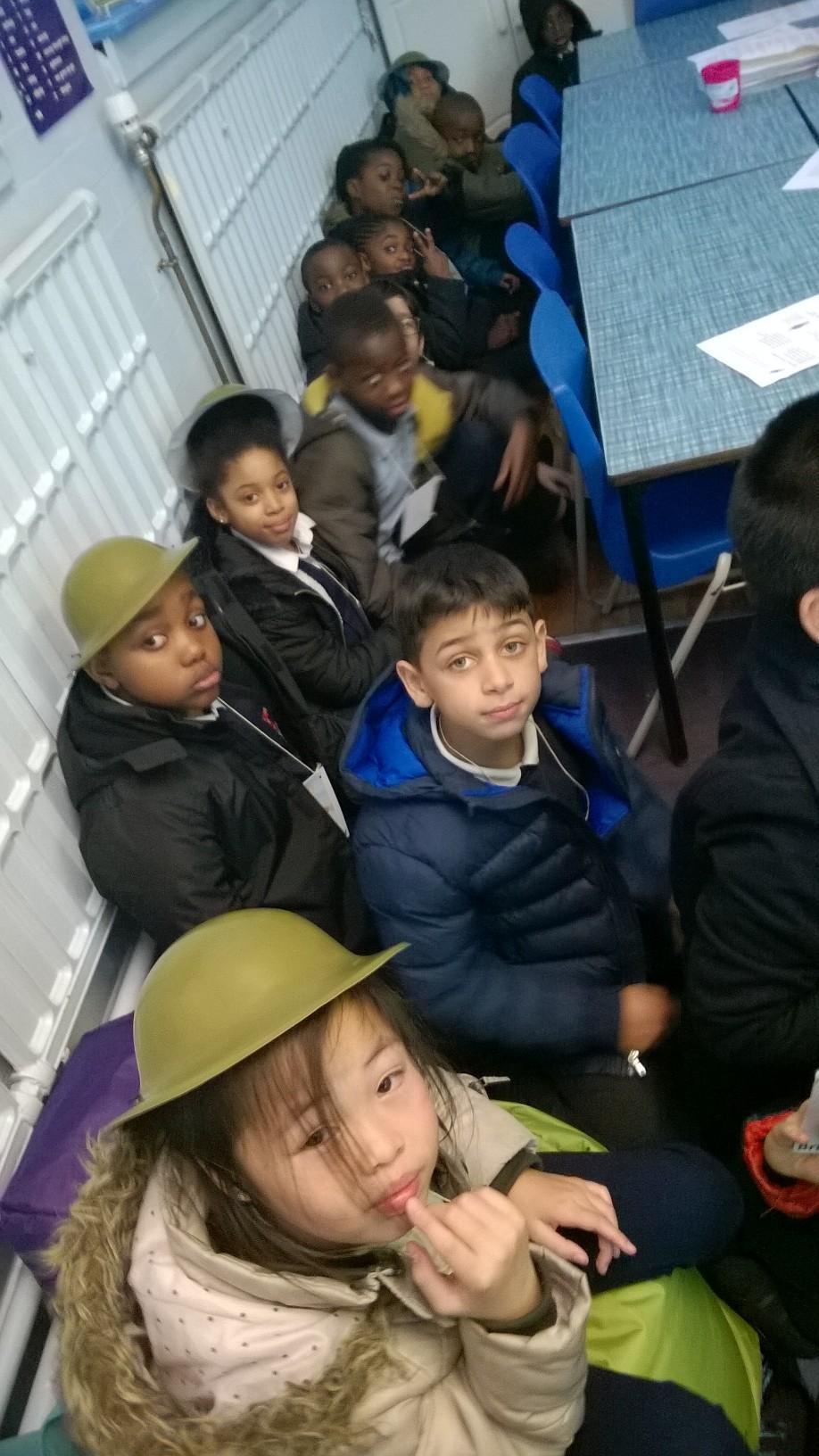 We were reading Michael Foreman's story of young men in the trenches 'War Game'. We re-enacted the Christmas Truce between British and German soldiers in the winter of 1914. Here, our Tommies are shivering together in their trench! We later wrote stories set in the First World War.