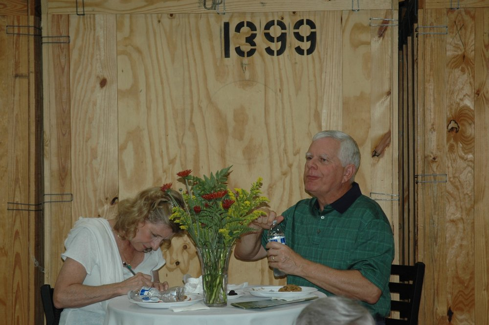 People at table with flowers prominent.jpg