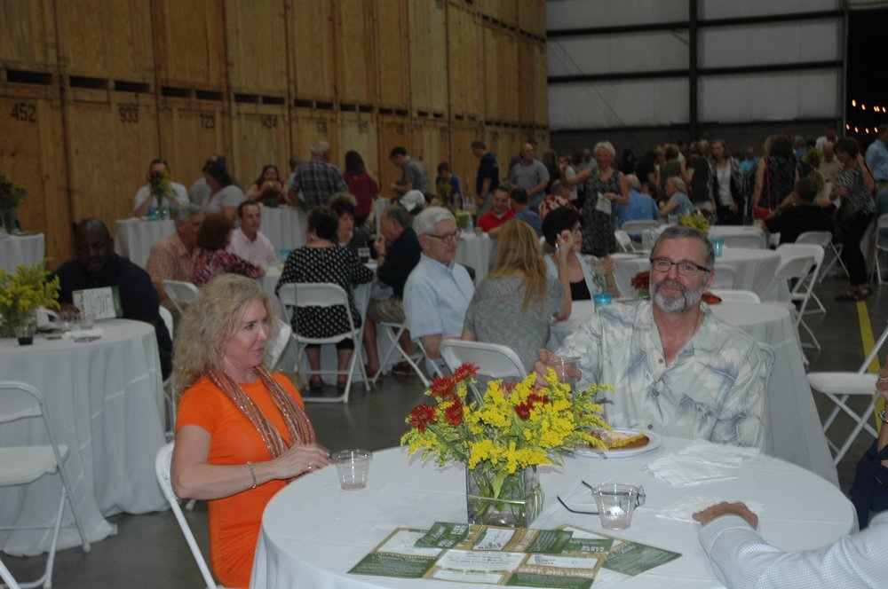 People sitting at tables Dave and Becky Hutchings.jpg