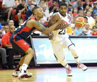 Damian Lillard (L) and Kyrie Irving are among the many point guards on Team USA. There will be roster cuts made on Saturday. Getty Images