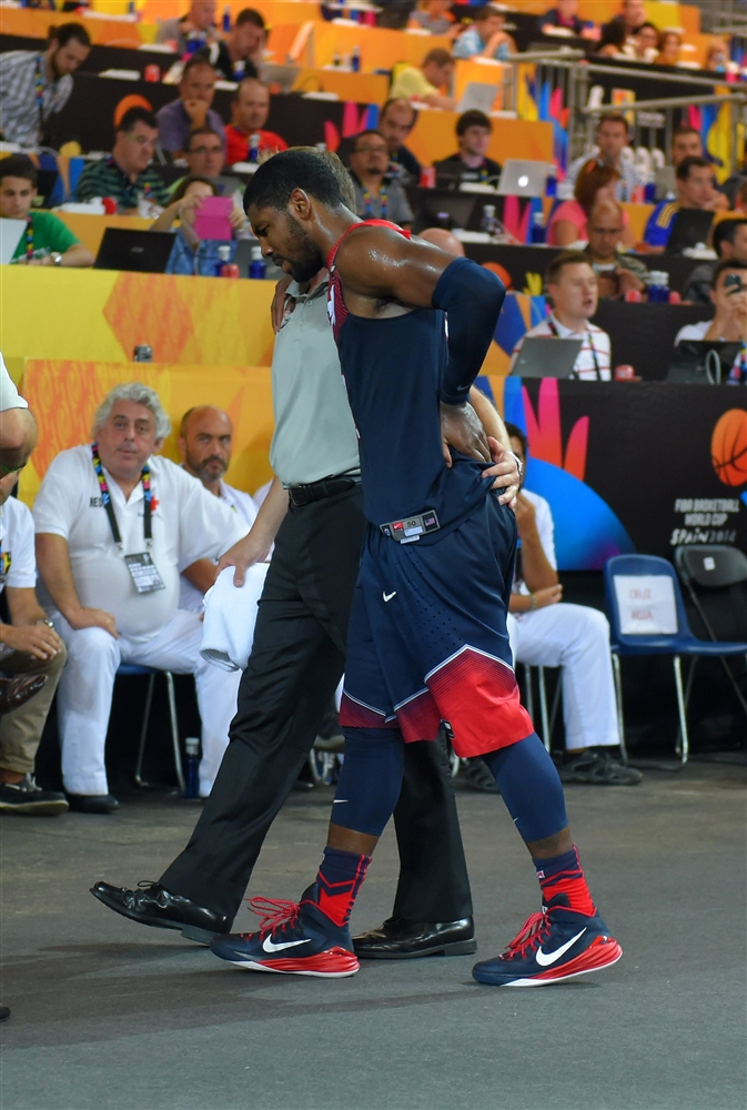 Kyrie Irving leaves the game early against Ukraine.
