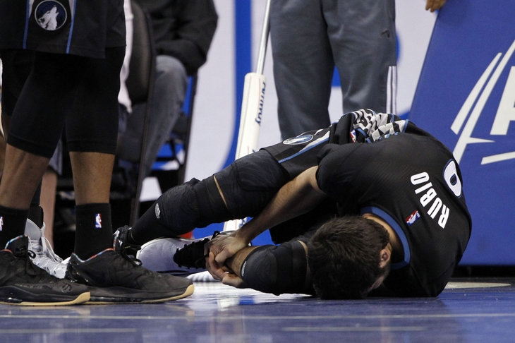 Ricky Rubio goes down with an ankle injury.