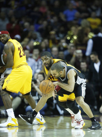 Kyrie Irving and Tony Parker battle for the ball.  Lonnie Timmons III/The Plain Dealer