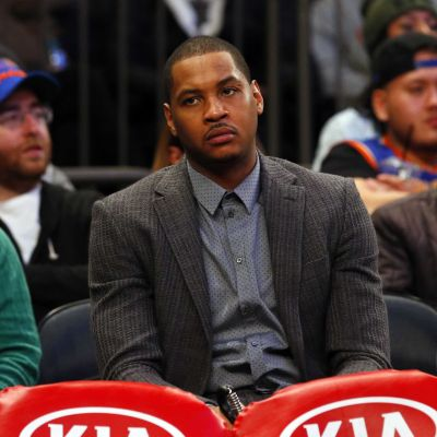The Knicks should get use to Carmelo Anthony wearing a suit.