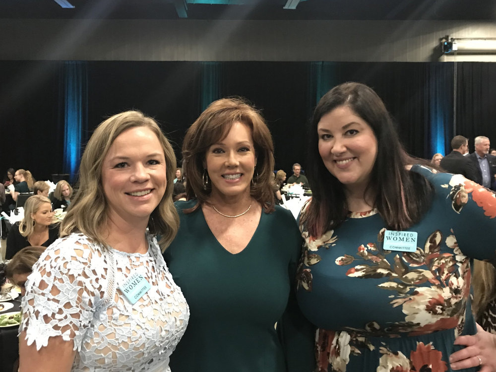 Ryan Worthington (of Worthington Monuments), Kelli Finglass (Executive Director of the Dallas Cowboys Cheerleaders), and Laura at the 8th Annual Inspired Women Luncheon (2018)