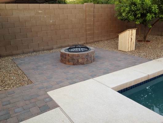 Pavers, fire pit and outhouse